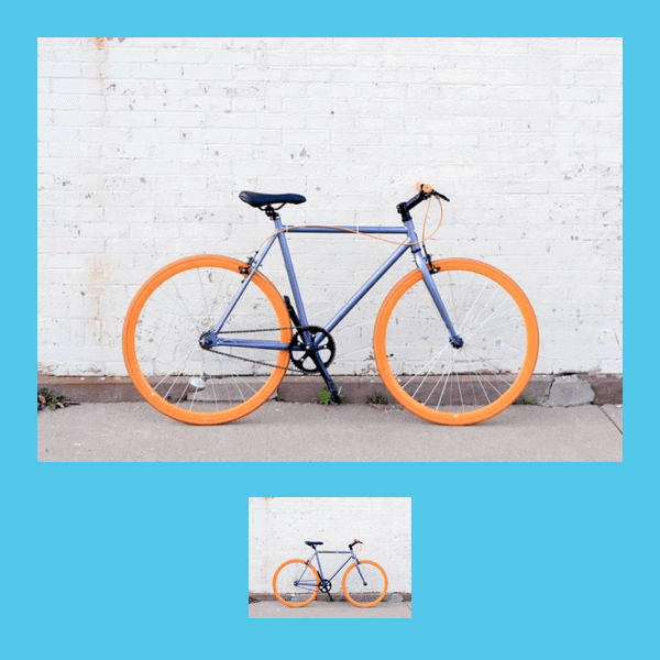 Bike with orange wheels against white and blue background.